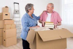 senior couple unpacking