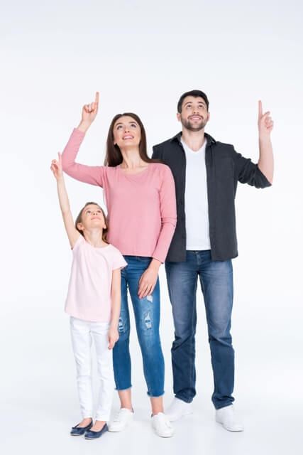 a family pointing at moving companies quotes