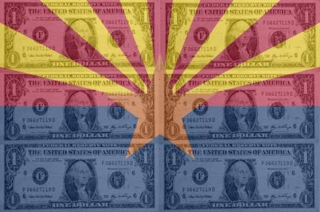 Dollar notes over Arizona flag