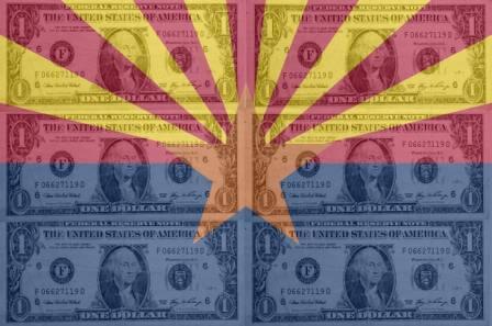 Dollar notes over Arizona flag